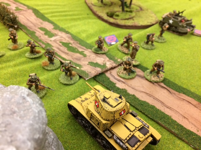 3-british-infantry-run-past-the-italian-tank